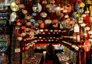 A shopkeeper waits for customers at the Grand Bazaar, known as the Covered Bazaar, in Istanbul